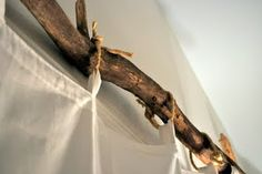 by cleverlyinspired. she has such good ideas! driftwood found on a lake used for a curtain rod in a cabin