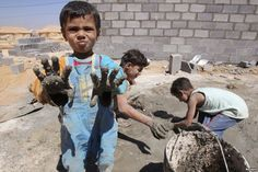 Syrian refugee children play with clay after workers end work at Al Zaatri refugee camp in the Jordanian city of Mafraq, near the border with Syria, September 2, 2012.