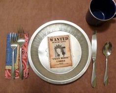 Fun table setting (including wanted posters as place setting cards) for cowboy, cowgirl, Wild West, and other birthday themes
