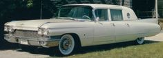Elvis Presley and his famous luxury gold Cadillac