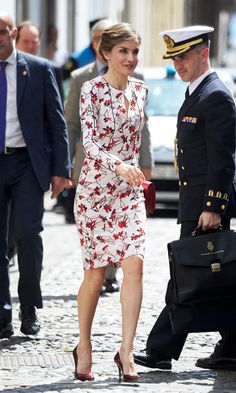 Queen Letizia pulled this Carolina Herrera floral number from her closet for a visit to Gran Canaria, Spain. The royal accessorized with a large red clutch bag and silver leaf Chanel earrings, along with a gorgeous pair of scarlet red heels by Marsala de Lodi.