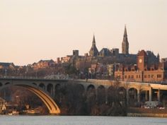 A view of Georgetown University (Healy Hall, Car Barn, etc) above Key Bridge. From Roosevelt Island, Washington, D.