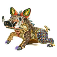 <strong>Amazing</strong>javelina woodcarving by artist Manuel Cruz.  Manuel Cruz is a talented woodcarver from Oaxaca. He has developed a style of his own, creating wonderful figures immaculately painted. This spectacular javelina or wild boar is particularly attractive….the coloring and painting are superb and the sense of movement impressive. Notice the wonderful carved,bass relief details such as the mane of this beautiful animal.