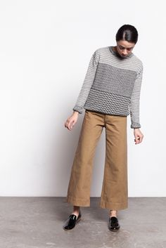 """Jesse Kamm's signature pant in tobacco cotton. High waist with concealed button fly featuring a white top button, belt loops, front horizontal pockets, darted back, and wide leg with cropped length.  100% Cotton  Cold Wash & Line Dry  Made in USA  Fits true to size. Model is 5""""7, wearing an xsmall (26.5""""). Pants will give 0.5"""" with wear."""
