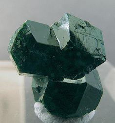 Uvarovite: Ca3Cr2(SiO4)3 Green uvarovite (garnet) crystal group. Mokkivaara mine, Outokumpu, Finland. Scale: 1.3x1.2x1 cm. / Mineral Friends <3