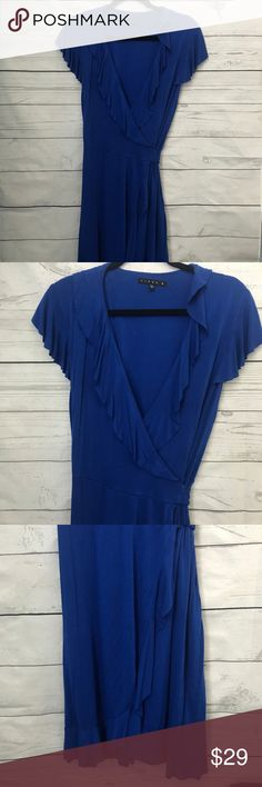 Tiana B Royal Blue Wrap Dress Tiana B Royal Blue Wrap Dress size Large. beautiful dress that is perfect for any occasion or season. ruffles around the edges and sleeves, real wrap dress that can be tied in the front side or in the back.  Nice knit fabric that does not wrinkle which makes it perfect for traveling. offers are welcome, no trades Tiana B Dresses Midi