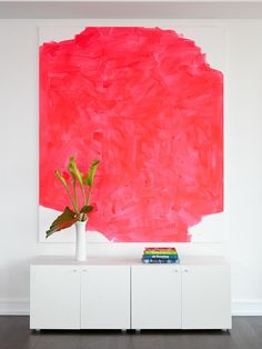 White Living Room With Modern Art. Make DIY Contemporary Art Brilliant strokes of pink in this painting create high-contrast drama against pure white walls and credenza in this space designed by Tara Benet. Grab a canvas and some brightly-hued leftover paint and create this look at home.