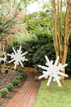 DIY Snowflake Yard Decor. These are perfect for winter, I'm either going to add white or blue, or a mix of both lights to really make them pop at night.