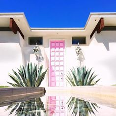 Indian Canyons is another must-see neighborhood in Palm Springs. Discover stunning examples of midcentury and Hollywood Regency architecture, as well as colorful doors, with #thatpinkdoor on E. Sierra Way being the most popular. We were so inspired by the colorful doors of Palm Springs, literal works of art in their own right, that we created the fine art photography series The Real Houses of Palm Springs—find it at @purephoto. —@kellygolightly + @fredbaby13 #myamericansummer