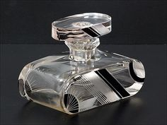 Art Deco Perfume bottle has black enamel strips with finely etched lines.