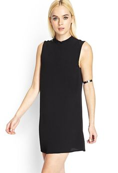 Minimal with a mod-inspired twist, this sleeveless dress features a funnel neck and swinging silh...