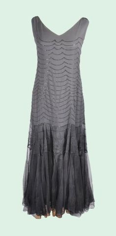 Robe in tulle and black crepe, embroidered with beads forming waves, scratched Jeanne Lanvin, circa 1930