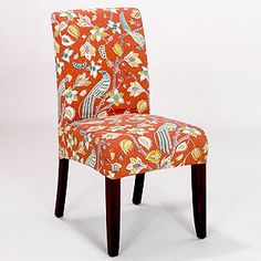 Accent chairs at dining table or as decorative seating in formal dining near windows with side table.