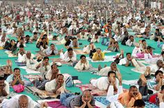 OM: Participants practiced yoga during Baba Ram Dev's free yoga camp in Gwalior, India, on Friday. Baba Ramdev touring the country, seeking public support against corruption. More than 10,000 people took part in the yoga camp. (Sanjeev Gupta/EPA)
