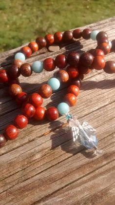 Check out this item in my Etsy shop https://www.etsy.com/listing/254953198/amazonite-angel-mala-prayer-beads