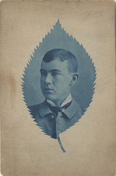 Unidentified photographer Portrait of a young man in a leaf mask n.d. Cabinet card, cyanotype   Private collection of Jack and Beverly Wilgus http://www.luminous-lint.com/__phv_app.php?/f/_cyanotypes_examples_01/