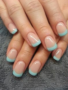 Baby blue and glitter inspired French manicure. The nails use a clear polish as the base coat and a baby blue polish for the tips. To add more into the design slight sprinkles of glitter are added to the tips.
