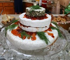 Cheese display Wedding Cake.  Levels of Brie & Goat Cheese layered with red pepper jelly.