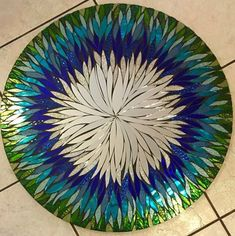 24 In. Any Color- 4 Week Lead Time Floral Handmade Glass Mosaic Mirror by Valerie WatsonThis is an all hand cut, handmade mosaic multi media Stained Glass mirror/ wall hanging.Blue and Purple Round Glitter Glass Mosaic by SolSisterDesignBrowse unique Stained Glass Mirror, Mirror Mosaic, Fused Glass Art, Mosaic Wall, Mosaic Glass, Mosaic Tiles, Mosaic Crafts, Mosaic Projects, Stained Glass Patterns