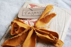 Vintage sewing pattern paper, paper scraps and fabric scraps torn and tied together to make ribbon. via the creative place