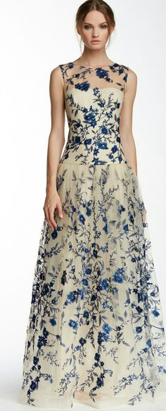 My daughter is having her reception in a beautiful 5 acre garden, with lots of trees, paths, and fountains. I like the idea of a dress like this covered in flowers!