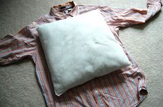 I know you all have seen shirt pillows before but after hearing about how the pillow cover tutorial  helped Erin, I thought I would post one...