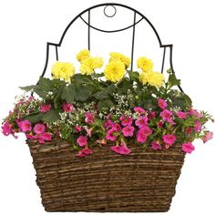 This rustic wall pocket planter is roomy enough for a large display of colorful annuals. Hand woven with sustainable materials on a sturdy wire frame and fully lined. Imagine how lovely this would be on your porch, garage or next to the front door!