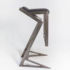 Designed by Urszula Kalczyńska, Graf-it design.  Futuristically looking, ergonomically correct and surprisingly comfortable bar stool. Natural, raw steel construction finished with a very soft leather seating.