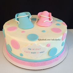 Gender reveal cake. He or she can't wait to see! It's a girl! Baby booties! www.facebook.com/cakesbyelise