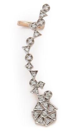 Kismet Right Diamond Ear CuffWhat's New DESCRIPTION A diamond-encrusted ear cuff in an elongated shape. Post closure.  14k rose gold. Total diamond weight: 0.32ct. Imported, Turkey. Kismet Right Diamond Ear Cuff $1,365.00 MEASUREMENTS Length: 1.75in / 4cm