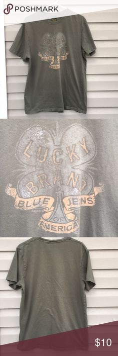 Lucky Brand men's army green short sleeve shirt Nice short sleeve shirt with picture of 4 leaf clover on front and 'Lucky Brand, Blue Jeans of America ' classic fit, 100% cotton, no snags, stains or holes. Lucky Brand Shirts Tees - Short Sleeve