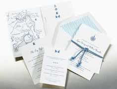 I love the map and subtle nautical theme with the striped envelope.