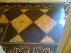 Hand painted floors. Great way to salvage wrecked/imperfect wood floors!