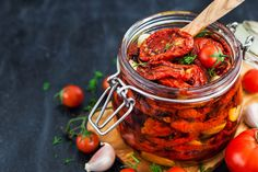 Sun dried tomatoes with garlic and olive oil in a jar by KateSmirnova. Sun dried tomatoes with garlic and olive oil in a jar on dark background Make Sun Dried Tomatoes, Small Tomatoes, Olives, Tomato Pesto, Tomato Vegetable, Easy Pasta Salad, Healthy Salad Recipes, Veggie Recipes, Italian Recipes