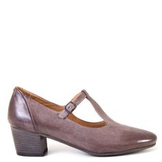 The Pantanetti Quip is the perfect low-heeled T-strap shoe, a sleek and sophisticated style that will stand the test of time. These shoes feature a soft almond toe and they are made of buttery soft leather, for supreme comfort throughout your day.  FREE Shipping in the contiguous USA Women's t-strap low heeled shoe Handmade in Italy Beautiful vegetable tanned calfskin upper Leather upper, lining, footbed and sole Leather sole with rubber heel tap 1¾ inch heel T-strap closure with silver-t...