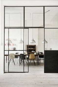 glass windows, tables, chairs, white walls