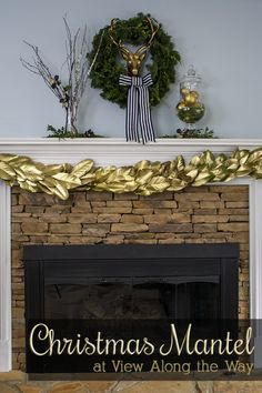 Christmas mantel! Magical combination of gold, black and white and greenery!