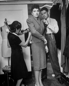John Dean of Bergdorf's working on fitted jacket for broad-shouldered suit.