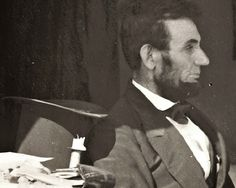 In this enlargement of Gardner's photograph, even the wick of a candle can be seen next to the top hat of the president, who nearly 18 months into the Civil War looks weary of it all American Revolutionary War, American Civil War, American History, Titanic Artifacts, Famous Photos, Civil War Photos, American Presidents, History Photos, Historical Photos