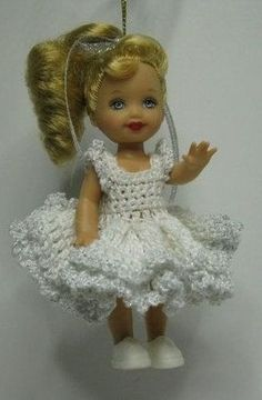 Kelly ornament doll plus white dress, boa and shoes, all inclusive gift. Such a…