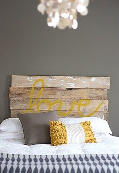 Must try this headboard! Yellow and grey master bedroom with distressed wood headboard. Not sold on the headboard but love the grey with pops of yellow for a master bedroom!