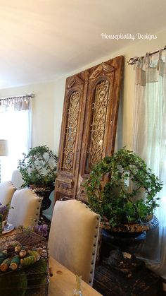 vintage doors and urns with topiary spheres