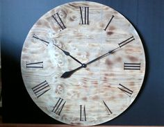 Oversized wall clock with burned wood and by ClockworksCanada