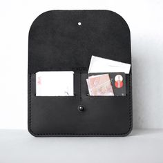 This great Unisex Wallet is made in Estonia, leather in black is a fantastic companion for every day! The Wallet impresses with its simple and elegant design, fulfilling all your needs - fitting credit cards, bank notes and latex. Each item is handmade.