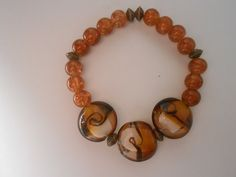 Stretch Lgt brown & dark brown glass beaded bracelet