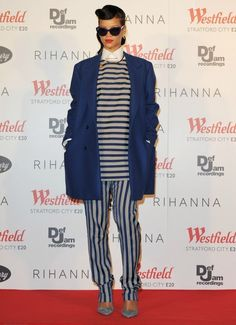 Rihanna wearing Sydney Evan Love Ring, Manolo Blahnik Ankle Strap Pump, Amy Zerner Serpent Ring, Meredith Kahn Ring, Acne Spring 2013 Top, Acne Spring 2013 Pants and Raf Simons Fall 2012 Coat.