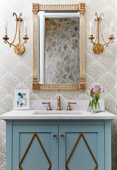 For this lush powder room, West Trade Interiors chose a pair of Oslo Sconces by E.F. Chapman in Gilded Iron. #circalighting