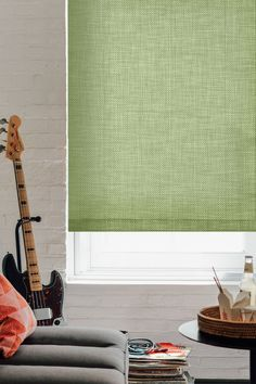Add a splash of green with Solar Shade in the Chilewich material Mini Basketweave, color Dill. | The Shade Store
