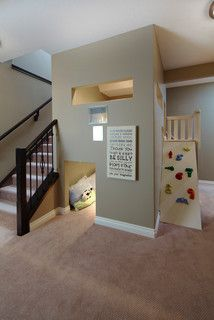 Cute little built in club house and slide. Great for a basement finishing job