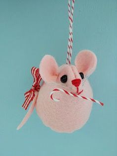 Several adorable homemade ornaments including this cute little mouse.